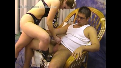 Horny Redhead Dominates Slave with her Leather Boot Heels and Blowjob Play