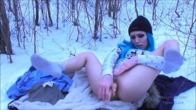 Naughty girl masturbates in winter forest