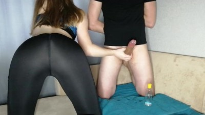 Girl in leggings jerking big cock of a friend and ruined orgasm
